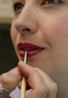 Expert makeup artist applying lip color